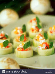 cucumber canapes cucumber canapés with sheep s cheese stock photo royalty free