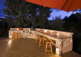 outdoor kitchen designs offering different cooking spaces traba