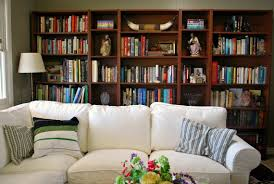 Behind Sofa Bookcase The Home Library