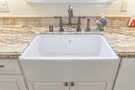 interior galey kitchen design with white apron front undermount