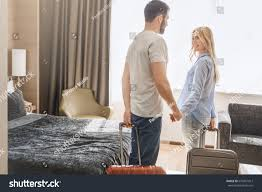 young couple room young couple travel together hotel room stock photo 670431013