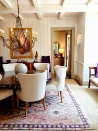 chic dining room with upholstered dining chairs and round wooden