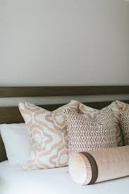 bolster bed pillows pink and brown bed pillows with brown wood bed transitional bedroom