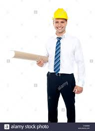 successful male builder holding blueprints and wearing yellow