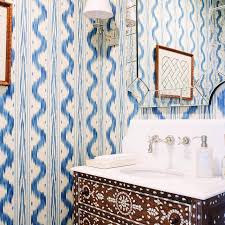 blue and brown powder room with mosaic tiled vanity transitional