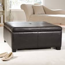 living room features square black leather ottoman coffee table