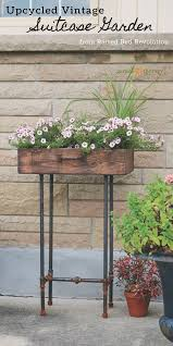 Planter With Legs by How To Make An Upcycled Suitcase Planter With Gas Pipe Legs