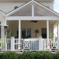 comfortable covered porch with adjacent grilling station patio