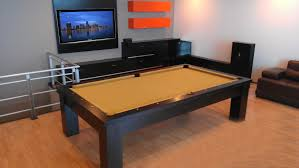 excellent dining room pool table faced off orange wall cabinets