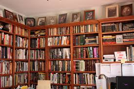magnificent building a home library with brown wooden finished