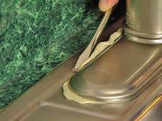 how to remove a faucet from a kitchen sink how to replace your kitchen faucet out an faucet to give