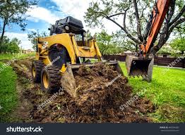 yellow mini bulldozer working earth moving stock photo 460704226