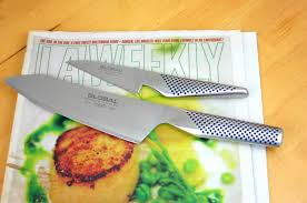 how do you sharpen kitchen knives how to sharpen kitchen knives with a newspaper food hacks daily