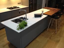 corian square raised breakfast bar on an alno kitchen designed by