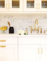 white kitchen cabinets with gold hardware kitchen with gold accents transitional kitchen kapito muller