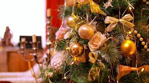 how to hang lights on a christmas tree in the background hang gold and white christmas balls on artificial