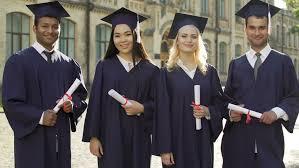 academic regalia graduate students in academic regalia talking and looking into