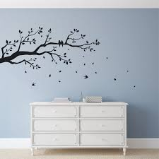 tree branch wall sticker with falling leaves flying and perched