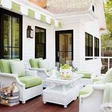 white wicker chairs with apple green cushions cottage den