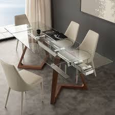 modern extendable dining table with tempered glass top iside