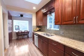 what backsplash looks with cherry cabinets kitchen backsplash designs traditional with cherry cabinets
