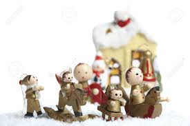 small wooden christmas tree decorations figures stand in the