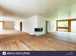 new apartment in cement and wood room with fireplace stock photo
