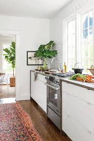 tiny kitchen inspiration that you ll want to pin southern living bright white tiny galley kitchen