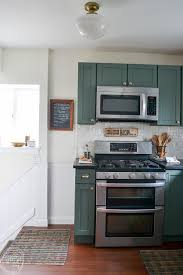white kitchen cabinets soapstone countertops modern kitchen with vintage touches budget friendly