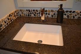 Vanity Backsplash Ideas - pebble mosaic backsplash modern bathroom vanities and sink