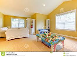 yellow kids play room with white sofa stock photography image