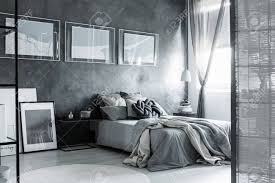 dark grey bedroom screen and posters in dark grey bedroom with bedsheets on king