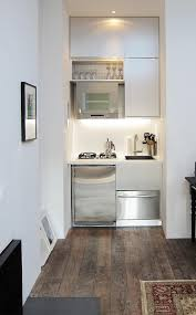 small black white apartment kitchen design with white cabinet and