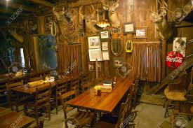 interior of rustic old restaurant with hunting džcor stock photo