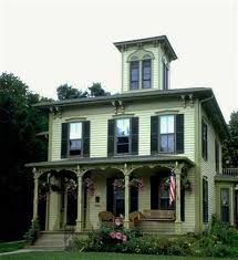 green exterior house paint this italianate style house looks