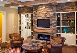 living room white track lamp fixtures ceiling stacked stone wall