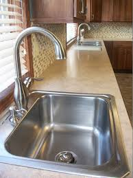artisan kitchen faucets permastone kitchen traditional with black fridge black microwave