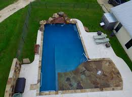 handicap accessible pool with wheelchair ramp side rails and
