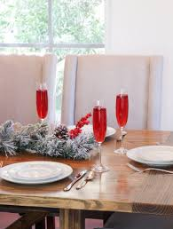 how to throw a classy holiday party on a budget pomegranate while i love all holiday decorations it s easy to go overboard with decor instead of busting out every single christmas decoration that you own