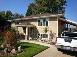 ogden insights super split entry shapeshift makeover what a remarkable transformation in this kind of home the roof and awning have been converted to a hipped prairie school style