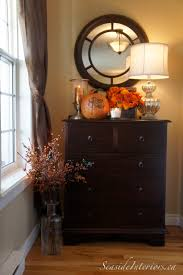 small dresser in entryway under a mirror u0026 fall decorations home