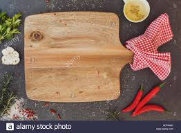cutting board plates empty wood cutting board with various fresh herbs and spices on