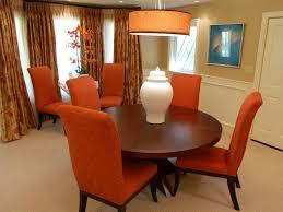 dining room round orange pendant lighting with orange fabric