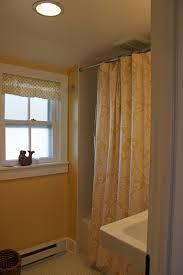 Bathroom Light Fan Heater Combo by Bahtroom White Window Plus Small Drapery And Artistic Artwork Near