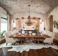 rustic dining room large cowhide area rug rustic wood floors