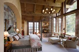 stone wall mountain lodge wood ceiling master bedroom custom