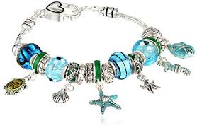 themed charm bracelet silver tone metal and glass themed bead charm