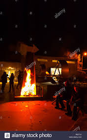 people sitting around an outdoor fireplace ironton studios and