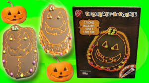 decorating pumpkin halloween cookies with pixie little kelly