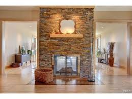 Traditional Double Sided Kitchen Double Sided Fireplace Separating The Kitchen And Living Room